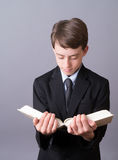 A boy reading the Bible Stock Photography