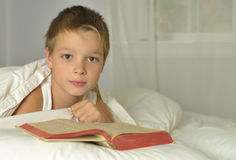 Boy is reading Bible Stock Images