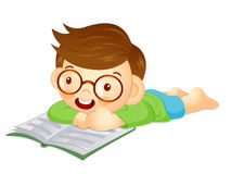Boy is reading a big book lying face down. Education and life Ch Stock Photography
