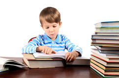 Boy reading a big book. Boy 5 yers reading a big book. isolated on white background. horizontal Royalty Free Stock Photo