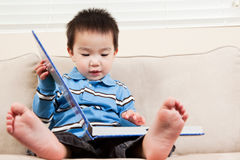 Boy reading a book. A portrait of an asian boy reading a book Royalty Free Stock Images