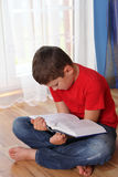 Boy reading book Stock Images