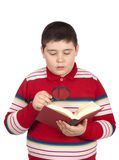 Boy reading a book Stock Photos