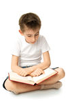 Boy Reading Book. A boy sitting on a floor and reading  big book Stock Photos