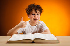 Boy reading book Stock Photo
