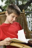 Boy reading book. Royalty Free Stock Images