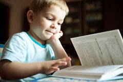 Boy reading book Royalty Free Stock Image