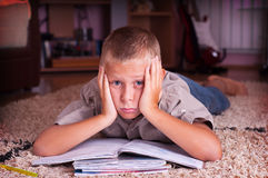 Boy reading book. Ten year old boy reading book, tired of learning process Stock Images