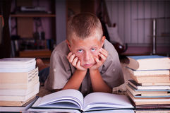 Boy reading book. Ten year old boy reading book, tired of learning process Stock Photos