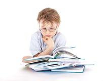 Boy reading a book Stock Photos
