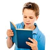 Boy reading book Stock Photos