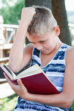 Boy is reading a book Royalty Free Stock Photo