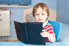 Boy is reading a book Royalty Free Stock Photos