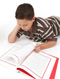 Boy reading a book Royalty Free Stock Image