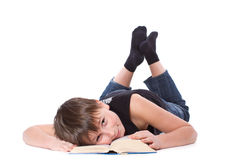 Boy reading a book Stock Photography