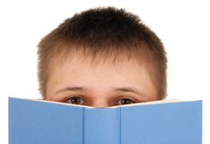 Boy Reading Book. Teenager reading a book isolated on white Royalty Free Stock Photography