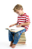 Boy reading book stock photography