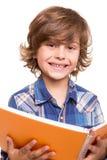 Boy reading book. Blond cute boy reading a book over white Stock Photos