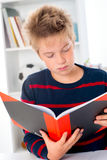 Boy is reading a book Stock Images