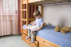 Boy Reading Book On Bunk Bed Royalty Free Stock Photography