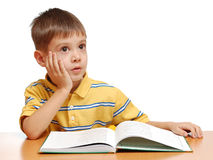 Boy reading a book and dreaming Stock Photo