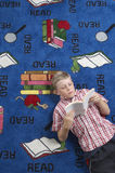Boy Reading Book On Floor Royalty Free Stock Photos