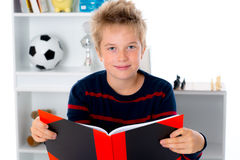 Boy is reading a book Royalty Free Stock Images