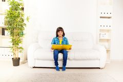 Boy reading book at home stock images