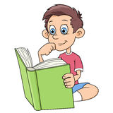Boy is reading a book Stock Photo