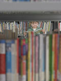 Boy Reading Book In Library Royalty Free Stock Image