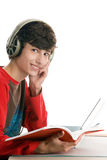 Boy reading book and listening to music Royalty Free Stock Images