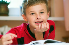 Boy reading book portrait stock photo