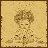 Boy reading a book Stock Photo