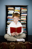 boy reading book sitting on the floor Royalty Free Stock Photography