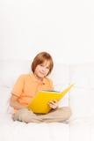 Boy reading book Stock Image