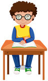 Boy reading book on the table Royalty Free Stock Photography