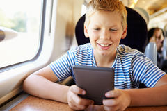 Boy Reading A Book On Train Journey Royalty Free Stock Image