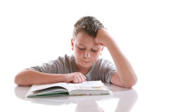 Boy reading a book. On a white background Royalty Free Stock Photography