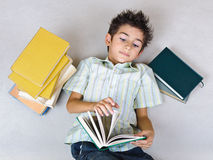 Boy reading books on the floor Stock Photography