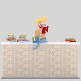 Boy reading on a brick wall Royalty Free Stock Photo
