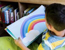 Boy Reading Children Story Book in Library Royalty Free Stock Photography