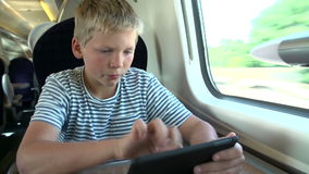 Boy Reading E Book On Train Journey Royalty Free Stock Photo
