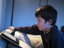 Boy Reading an Electric Book Stock Photography