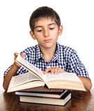Boy reading heavy big book Stock Photos