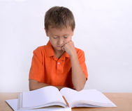 Boy reading homework Royalty Free Stock Photo