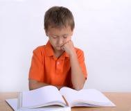 Boy reading homework Royalty Free Stock Photo