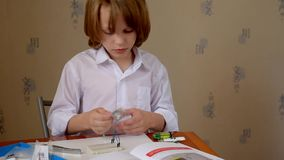 Boy reading instruction stock video footage