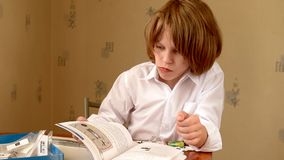 Boy reading instruction stock footage