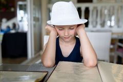 Boy reading menu in restaurant or cafe. Royalty Free Stock Image