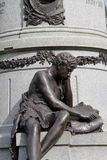 Boy reading monument detail Stock Image